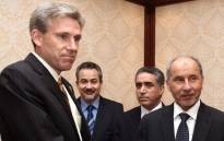 A picture dated June 7, 2012 shows US ambassador to Libya, J. Christopher Stevens (L), shaking hands with Libyan National Transitional Council (NTC) chairman Mustafa Abdel Jalil (R) after presenting his credentials during a meeting in Tripoli. Stevens, and three officials were killed when a mob attacked the US consulate in the eastern city of Benghazi, the interior ministry said on September 12, 2012. Picture: AFP.