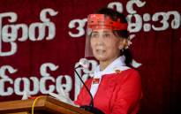 FILE: Myanmar's political leader Aung San Suu Kyi wears a face shield as she attends a ceremony to mark the 32nd anniversary of the National League for Democracy (NLD) in Naypyidaw on 27 September 2020. picture: Thet Aung/AFP