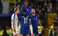Chelsea's English midfielder Callum Hudson-Odoi (C) leaps into the arms of Chelsea's English midfielder Ruben Loftus-Cheek after scoring their third goal during the first leg of the UEFA Europa League round of 16 football match between Chelsea and Dynamo Kiev at Stamford Bridge stadium in London on 7 March 2019. Picture: AFP