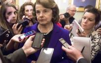 Senate Intelligence Chairwoman Dianne Feinstein (C) speaks to reporters about the committee's report on CIA interrogations in Washington on 9 December, 2014. Picture: AFP.