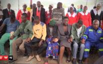 FILE: Members from all 3 families of the trapped mineworkers at Lily Mine sitting and praying together. Picture: EWN