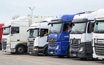 Drivers sit in their cabs as they wait at a truck stop off the M20 leading to Dover near Folkestone in Kent, southeast England on 22 December 2020, after France closed its borders to accompanied freight arriving from the UK due to the rapid spread of a new coronavirus strain. Picture: AFP