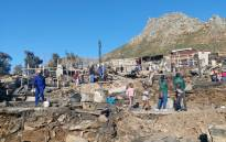 More than 800 people were displaced after hundreds of shacks were gutted in a fire at the Imizamo Yethu informal settlement in Hout Bay on 6 September 2020. Picture: Kaylynn Palm/EWN