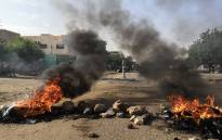 Tyres are set ablaze by Sudanese protesters during a rally in the capital Khartoum to condemn the 'massacre' of five demonstrators including four high school students at a rally in the cantral town of Al-Obeida on 29 July 2019. Picture: AFP