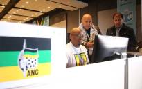Western Cape ANC provincial secretary Faiz Jacobs and other ANC officials at the IEC results centre in Cape Town. Picture: Bertram Malgas/EWN.