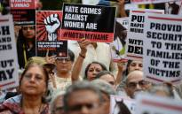 Indian demonstrators hold placards during a silent protest 'Not In My Name' in support of rape victims following high profile cases in Jammu and Kashmir and Uttar Pradesh states in New Delhi on 15 April, 2018. Picture: AFP