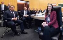New Zealand's Prime Minister Jacinda Ardern (R) attends a cabinet meeting on her first day at Parliament in Wellington on 6 August 2018, after returning from maternity leave. Picture: AFP