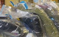 Approximately 148 dagga plants and 24 bags containing processed dagga were found in an air-conditioned room. More bags of processed dagga were found in the house whilst some were stashed in the ceiling. Picture: Saps/Twitter