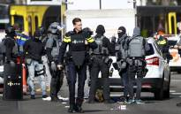 Police forces stand near a tram at the 24 Oktoberplace in Utrecht, on 18 March 2019 where a shooting took place. Picture: AFP