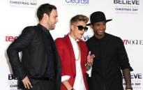 "FILE: Producer Scooter Braun, singer/producer Justin Bieber and producer Usher arrive at the premiere Of Open Road Films' ""Justin Bieber's Believe"" at Regal Cinemas LA Live on 18 December, 2013 in Los Angeles, California. Picture: AFP."