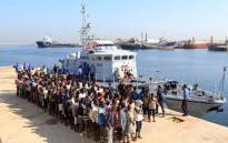 Illegal migrants from Africa stand in line at a naval base in Tripoli after being rescued by Libyan coastguards in the Mediterranean Sea off the Libyan coast on 29 August 2017. Picture: AFP