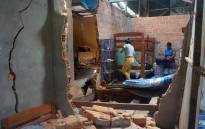 FILE: People salvage belongings after a quake-damaged their house in Yurimaguas, in the Peruvian Amazon region, on 26 May 2019. A strong 8.0-earthquake struck northern Peru in the early hours of Sunday, sending residents fleeing their homes and cutting off power to at least one town, with the impact felt as far afield as neighbouring Ecuador. Picture: AFP