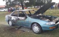 An elderly man and his 4-year-old grandson burnt to death in car in Azaadville on 8 April 2015. Picture: @SAPoliceService.