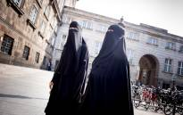 Women in niqab are pictured after the Danish Parliament banned the wearing of face veils in public, at Christiansborg Palace in Copenhagen, on 31 May 2018. Picture: Reuters