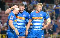 South Africa's Stormers no 8 Jaco Coetzee (L) is congratulated by his teammates after scoring a try during the Super Rugby match between South Africa's Stormers and Japan's Sunwolves at Newlands Stadium in Cape Town on 8 June 2019. Picture: AFP