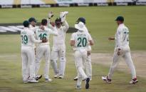 South Africa's Keshav Maharaj (3rdL) celebrates with teammates after the dismissal of England's Dom Sibley during the third day of the first Test cricket match between South Africa and England at The SuperSport Park stadium at Centurion near Pretoria on 28 December 2019. Picture: AFP.