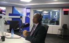 Johannesburg Mayor Herman Mashaba talks to Karima Brown during an interview on Talk Radio 702. Picture: Refilwe Pitjeng/EWN.