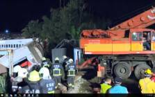 A screengrab of rescue workers on the scene of a train crash in Taiwan.
