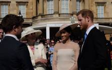 FILE: The Duchess and Duke of Sussex, Meghan Markle and Prince Harry (right), attend an event in the gardens of Buckingham Palace on 22 May 2018. Picture: @KensingtonRoyal/Twitter