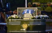 The urn with the ashes of Cuban leader Fidel Castro leave the Revolution Square in Havana starting a four-day journey across Cuba, November 30, 2016. Picture: AFP
