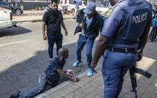 JMPD K9 and Saps officers detain a suspect in an attempted mall robbery in Brixton, Johannesburg. Picture: Thomas Holder/EWN