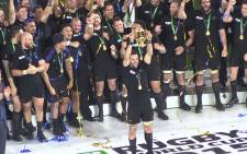 All Blacks captain Richie McCaw hoists the William Web Ellis trophy at Twickenham after his team beat Australia in the final. Picture: Vumani Mkhize/EWN.