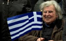 Greek composer Mikis Theodorakis takes part in a demonstration, in Syntagma square in central Athens on February 4, 2018, to urge the government not to compromise in the festering name row with neighbouring Macedonia. ANGELOS TZORTZINIS / AFP