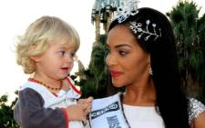 Twenty-two-month-old Sam Stephens with Miss South Africa Liesl Laurie. Picture: Yolanda ver der Stoep.