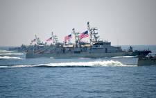 A US Navy ship fired warning shots when an Iranian vessel in the Gulf came within 137 meters, a US official said. Picture: Twitter/@VOP_Today.