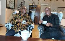EFF leader Julius Malema and former President Jacob Zuma sipping tea at his Nkandla homestead on 5 February 2021. Picture: Facebook/EFF