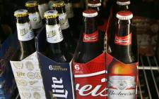Bottles of Budweiser and Miller Lite beer. Belgium's Anheuser-Busch InBev, which owns Budweiser and is the world's largest brewer, is in takeover talks for the number two positioned British-based SABMiller, owner of the Miller beers. Picture: Getty Images/AFP.