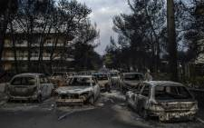 Burnt cars following a wildfire at the village of Mati, near Athens, on 24 July 2018. Picture: AFP