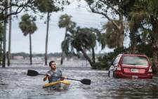 Justin Hand navigates storm surge flood waters from Hurricane Irma along the St Johns River on 11 September 2017 in Jacksonville, Florida. Picture: AFP