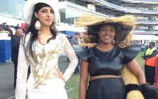 """The woman with a straw hat and bag says her Durban July outfit was inspired by the thatched roofing of Nkandla, Picture: Vumani Mkhize/EWN."""""""