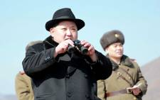A file photo released by North Koreas official Korean Central News Agency on 21 February, 2016 shows North Korean leader Kim Jong-Un inspecting a flight drill of fighter pilots of the Korean Peoples Army Air and Anti-Air Force at an undisclosed location. Picture: AFP.