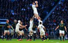 England's flanker Chris Robshaw (Top) secures the line-out ball during the Autumn International rugby union Test match between England and South Africa at Twickenham Stadium, southwest of London on 15 November, 2014. Picture: AFP.