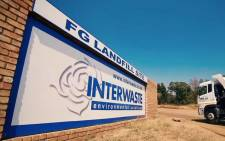 A YouTube screengrab shows an Interwaste landfill site.