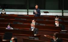 Hong Kong lawmaker Cheng Chung-tai (back C) speaks during a meeting at the Legislative Council in Hong Kong on 12 November 2020, a day after pro-democracy lawmakers said they would all quit in protest at the ousting of four of their colleagues by the city's pro-Beijing authorities. Picture: AFP