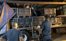 Western Cape police inspect a truck loaded with abalone with an estimated street value of R28 million. Picture: SAPS.
