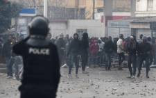 Tunisian protesters clash with security forces in the town of Tebourba on 9 January 2018, following the funeral of a man who was killed the previous day in a demonstration over rising costs and government austerity. Picture: AFP