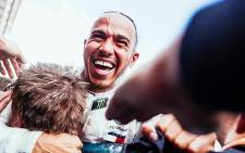 Mercedes' Lewis Hamilton celebrates with his team after beating Valtteri Bottas in the Spanish Grand Prix. Picture: @MercedesAMGF1/Facebook.com.