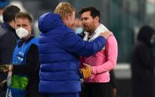 Barcelona manager Ronald Koeman (left) and club captain Lionel Messi share a word following the side's victory over Juventus in their Uefa Champions League match on 28 October 2020. Picture: AFP