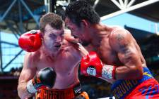 Jeff Horn and Manny Pacquiao during their WBO welterweight world title fight. Picture: AFP