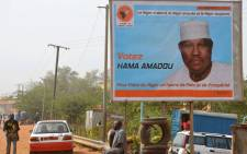 A picture taken on February 2, 2016 in Niamey shows a campaign poster depicting NIger's leading opposition figure and contender in next month's presidential election Hama Amadou. Picture: AFP.