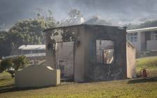 FILE: Several cottages at the Oatlands Holiday Village were gutted when the mountain fire moved into residential areas in Simon's Town on 19 November 2015. Picture: Aletta Harrison/EWN.