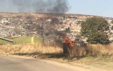 Residents of Marlboro informal in Alexandra torched a house and a transformer after their homes were demolished by the Red Ants on 31 May 2019. Picture: Robinson Nqola/ EWN.