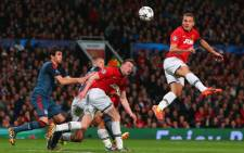 Manchester United's Nemanja Vidic jumps to head the ball during the Champions League match against Bayern Munich at Old Trafford on 1 April 2014. Picture: Facebook.