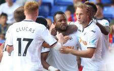 Swansea City's Jordan Ayew (centre) celebrates with teammates after scoring the second goal. Picture: @SwansOfficial/Twitter.
