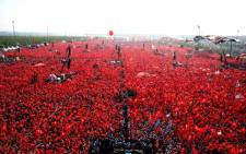 This handout picture released by Turkey's Presidential Press Service and taken on 7 August 2016 shows people waving Turkish national flags as they gather at Yenikapi in Istanbul during a rally against failed military coup on 15 July. Picture: Turkey's Presidential Press Service/AFP.