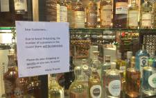 An alcohol store asks customers to complete their purchases quickly. Picture: Supplied